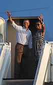 United States President Barack Obama and first lady Michelle Obama wave goodbye to well wishers at Joint Base Pearl Harbor-Hickam, Honolulu, Hawaii, Monday, January 2, 2012.Credit: Cory Lum / Pool via CNP