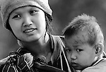 A mother with her son in a mountain village in Chiang Rai, Thailand.