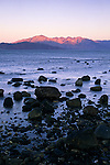 Evening alpenglow on desert mountains above Bahia de los Angeles at low tide, Baja California, Mexico