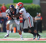 Mississisppi's Zack Stoudt (8) is tackled by Georgia linebacker Jarvis Jones (29) at Vaught-Hemingway Stadium in Oxford, Miss. on Saturday, September 1724, 2011. (AP Photo/Oxford Eagle, Bruce Newman)..