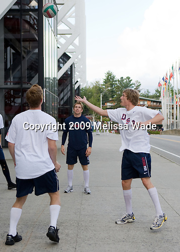 Vinny Saponari (US - 19), David Warsofsky (US - 5), Robbie Czarnik (US - 12) - Team USA warms up outside the rinks prior to their second game against Team Russia during the 2009 USA Hockey National Junior Evaluation Camp on Wednesday, August 12, 2009, in the USA (NHL-sized) Rink in Lake Placid, New York.
