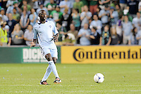 Lawrence Olum (13) Sporting KC defender in action... Sporting Kansas City defeated New England Revolution 3-0 at LIVESTRONG Sporting Park, Kansas City, Kansas.