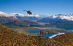 Hughes 500 Helicopter and tourists above Lake Wanaka Otago New Zealand
