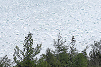A view of an icy Lake Superior shoreline as seen from Sugarloaf Mountain in winter in Marquette Michigan Upper Peninsula.