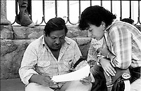 Daniel Lopez Nelio (L) reviews papers with a comrade as he started a hunger strike at the Mexico City Cathedral to protest against fraud in municipality elections in Juchitan, Oaxaca, November 30, 1983.  © Photo by Heriberto Rodriguez
