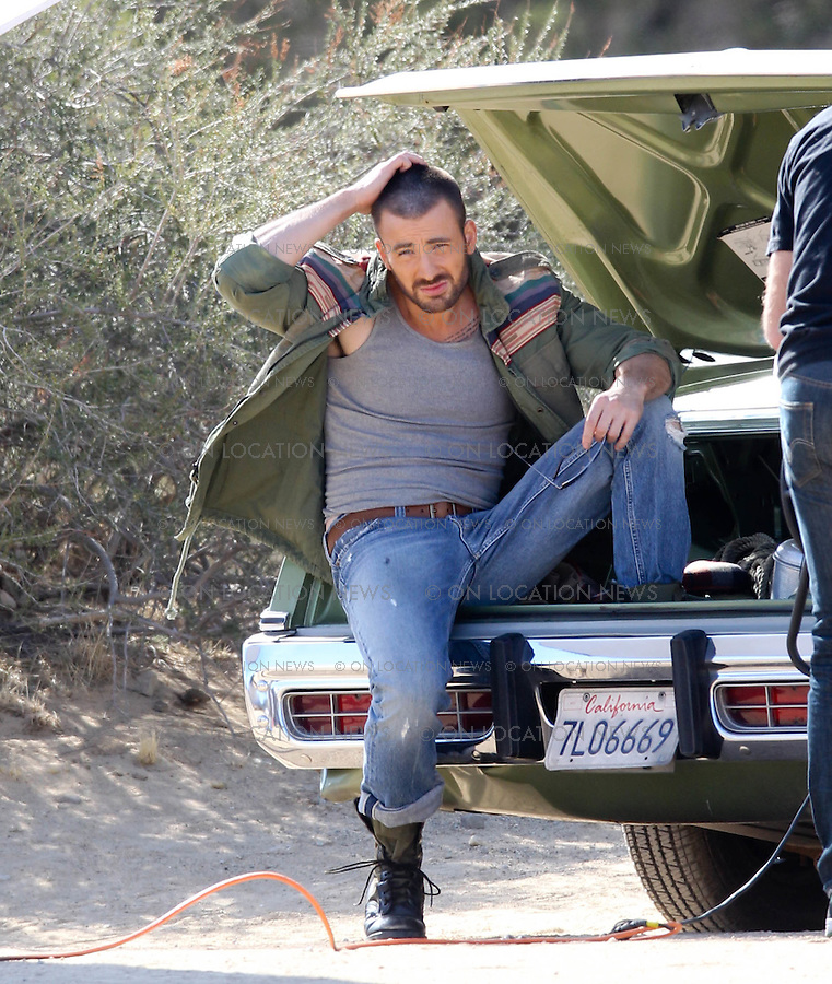 """February 01, 2012 Santa Clarita, CA.***EXCLUSIVE*** Chris Evans, the hunky star of """"Captain America"""" & """"The Avengers"""" shoots a sexy photo shoot for Details Magazine at Vasquez Rocks Park outside of Los Angeles. A bizarre show of public affection took place between Chris Evans and 3 different women working on set. Chris was seen heavily flirting, hugging, kissing and even groping all 3 women whom all seemed very happy and friendly with Chris. The 3 women in question was his Make-Up Artist, his Wardrobe Dresser and a woman who interviewed Chris on camera after the photo shoot . Photo by Eric Ford/On Location News 1/818-613-3955 info@onlocationnews.com"""