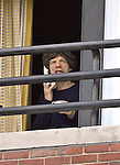 """Coffee, Tea or MICK??"" Friday the 13th finds Rolling Stone Mick Jagger peering out his Four Seasons' Hotel presidential suite window in Boston just hours before tonite's show. photo by Mark Garfinkel  October 26, 2006"