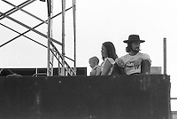 Folks with a Baby on Stage at The Grateful Dead Concert at Dillon Stadium on 31 July 1974. These folks were sitting Stage Left, over beyond Keith, enjoying the show. Not sure who they are. Anyone with info please contact me. Thanks!