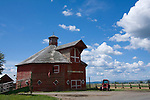 Oregon, Enterprise, Joseph. The unique octagonal barn of Crossed Sabers Ranch and red tractor.