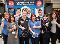 Phil 'The Power' Taylor raised money for The Children's Hospital Charity by challenging the public at darts at Sheffield Train Station. Here Phil get's the thumbs up from East Midlands Trains staff.