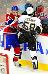 6 February 2010: Montreal Canadiens' center Ben Maxwell checks Pittsburgh Penguins defenseman Kris Letang in the second period at the Bell Centre in Montreal, Quebec, Canada. The Canadiens defeated the Penguins 5-3. Mandatory Credit: Ed Wolfstein Photographer