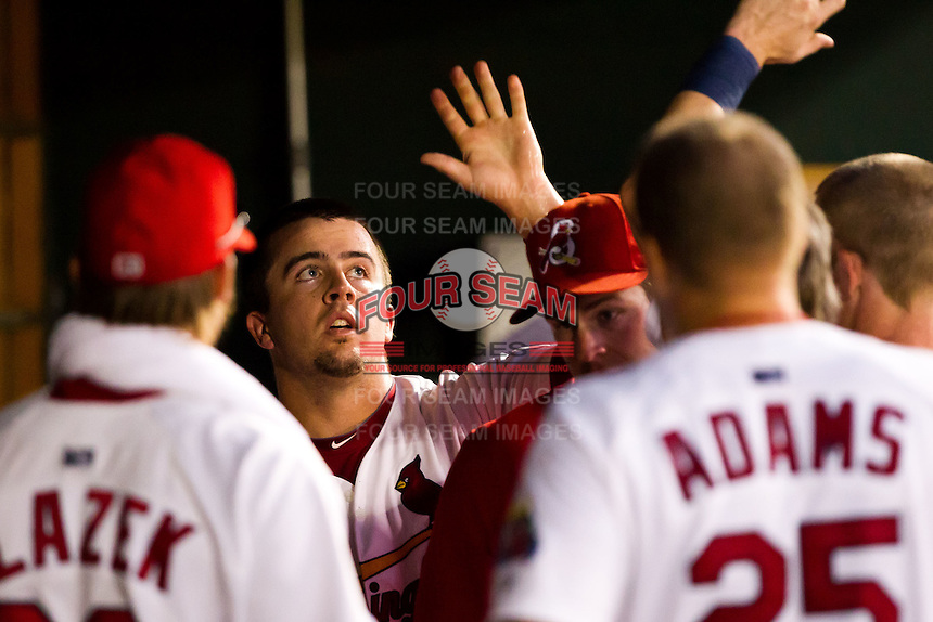 Zack Cox (7) of the Springfield Cardinals is congratulated by teammates after scoring during a game against the Tulsa Drillers at Hammons Field on July 20, 2011 in Springfield, Missouri. Springfield defeated Tulsa 12-1. (David Welker / Four Seam Images)