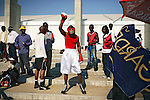 SOWETO, SOUTH AFRICA SEPTEMBER 23: A boxer prepares to go inside the ring for a match on September 23, 2006 in Soweto, Johannesburg, South Africa. The tournament was part of Soweto festival. Soweto is South Africa?s largest township and it was founded about one hundred years to make housing available for black people south west of downtown Johannesburg. The estimated population is between 2-3 million. Many key events during the Apartheid struggle unfolded here, and the most known is the student uprisings in June 1976, where thousands of students took to the streets to protest after being forced to study the Afrikaans language at school. Soweto today is a mix of old housing and newly constructed townhouses. A new hungry black middle-class is growing steadily. Many residents work in Johannesburg but the last years many shopping malls have been built, and people are starting to spend their money in Soweto.  .(Photo by Per-Anders Pettersson/Getty Images).