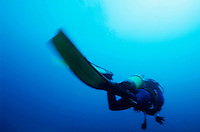 Blurred diver silhouette in the blue