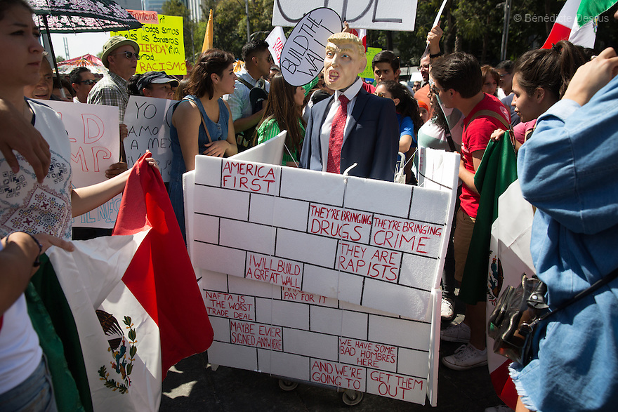 Thousands hold signs against US President Donald Trump during an anti-Trump march in Mexico City, Mexico on February 12, 2017. Photo by Bénédicte Desrus