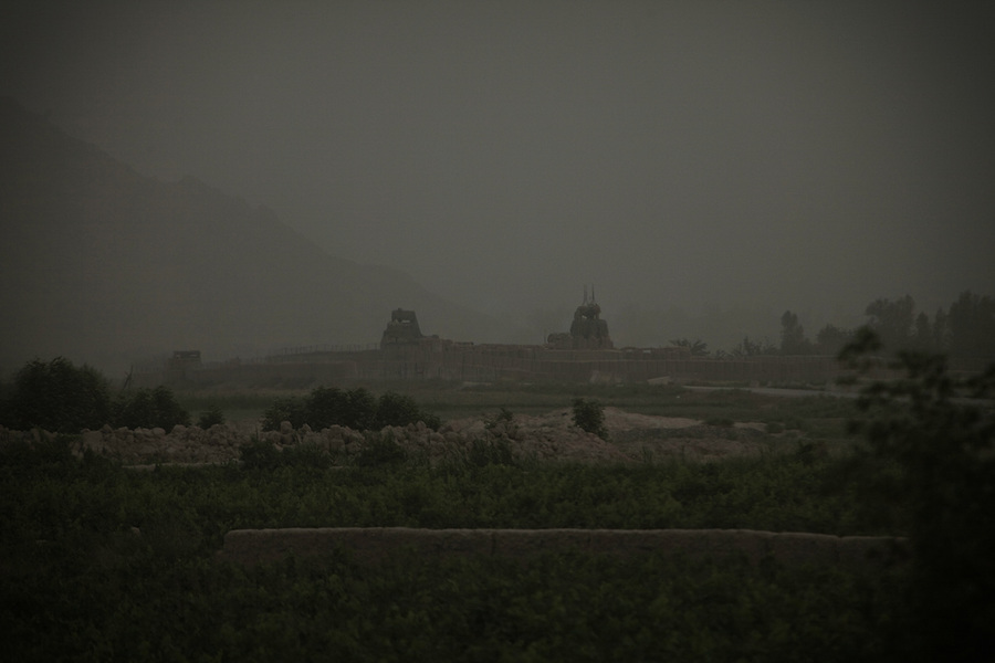 Combat Outpost JFM is visible through the evening haze in Zhari District, Kandahar, Afghanistan. The violently contested district sits astride the strategically Highway 1 ringroad between Kandahar and Lashkar Gah and is seen by some as the birthplace of the Taliban movement.