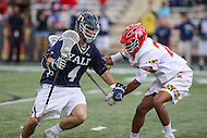 College Park, MD - February 25, 2017: Yale Bulldogs John Daniggelis (4) is being defended by Maryland Terrapins Isaiah Davis-Allen (26) during game between Yale and Maryland at  Capital One Field at Maryland Stadium in College Park, MD.  (Photo by Elliott Brown/Media Images International)