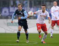 Fussball 2. Bundesliga:  Saison   2012/2013,    14. Spieltag  TSV 1860 Muenchen - 1. FC Koeln  16.11.2012 Daniel Bierofka  (li, 1860 Muenchen) gegen Adam Matuschyk (1. FC Koeln)