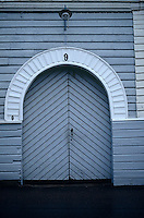 Traditional Finnish woodwork is exemplified in the large double doors to the entrance of this country house