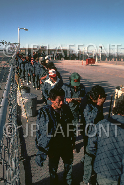 January, 1983. Tijuana, Mexico. Near the Tijuana border illegal immigrants are put in jail. Many of the illegal immigrants come from Central America, and are held until they are sorted, dispatched and deported back to their countires.