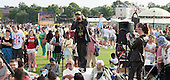 "Natty Speaks, rapper (www.nattyspeaks.com), at ""Showtime"", part of the London 2012 Festival of Arts to celebrate the London Olympics.  A family fun spectacle including dance, painting, music, acrobatics and some large mobile dynosaurs walking amongst the crowd.  On Blackheath Common, Saturday August 4th and funded by the Mayor of London and Arts Council England."