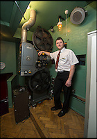 BNPS.co.uk (01202 558833)<br /> Pic: PhilYeomans/BNPS<br /> <br /> Andy with the huge projector - even the flooring came from an ABC projection room.<br /> <br /> Field of Dreams....<br /> <br /> Film buff Andy Jones has built an ABC cinema in his back garden as a lasting tribute to the now defunct movie company.<br /> <br /> Andy, 38, has taken four and a half years and spent &pound;70,000 of his life savings building the 34-seat cinema from scratch.<br /> <br /> The father-of-two's movie house mirrors cinemas of the 1930s with big red curtains, red seats and a parquet floor in the projection room. <br /> <br /> The brick building, which is adorned with an ABC sign, is 40ft tall, 22ft wide and 20ft high and takes up half of the garden of his three bed semi-detached house.<br /> <br /> The theatre, which has a 17ft by 7ft screen, has its own projection room, black and white old-style toilets and a foyer with a concessions stand that offers popcorn and sweets.
