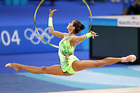 Irina Tchachina of Russia split leaps to recatch hoop during early qualification roundl at 2004 Athens Olympic Games on August 26, 2006 at Athens, Greece. Irina won silver in the All-Around final. (Photo by Tom Theobald)