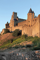 Square Pinte Tower on the left, Justice Tower on the right, Citadel of Carcassonne, Aude, France. Carcassonne was a stronghold of Occitan Cathars during the Albigensian Crusades but was captured by Simon de Montfort in 1209. He added extra fortifications and Carcassonne became a citadel on the French border with Aragon. The fortress restored in 1853 by Eugene Viollet-le-Duc. Today it is a UNESCO World Heritage site. Picture by Manuel Cohen