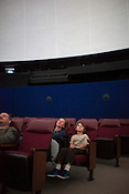 Christie Campbell-Seiberling and her son, Owen, watch The Longest Night, a film created by Paperhand Puppet Intervention and UNC, specifically for the domed screen of Morehead Planetarium on the campus of UNC Chapel Hill, N.C., Thursday, Nov. 1, 2012.