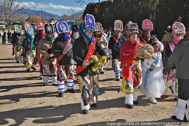 The Monarcha leads a group of colorful Matachine dancers along with a young girl dressed in white who portrays the character of Malinche during the December celebration of the Virgin of Guadlaupe FeastDay at the village of Tortugas near Las Cruces, New Mexico