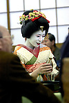 A geisha pours drinks for customers at a geisha house in Tokyo, Japan.