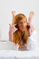 Young red haired woman with hair over her face