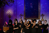 American singer-songwriter Sara Bareilles, left, performs during a state dinner honoring Prime Minister Justin Trudeau of Canada and Mrs. Sophie Gr&eacute;goire Trudeau at the White House March 10, 2016 in Washington, DC. <br /> Credit: Olivier Douliery / Pool via CNP