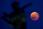 The full moon rose up behind the statue of Giants Willie McCovey. The full moon is called the harvest moon because its bright light (12 times brighter than that of a quarter moon) allows farmers to continue harvesting crops in the field well after sunset.