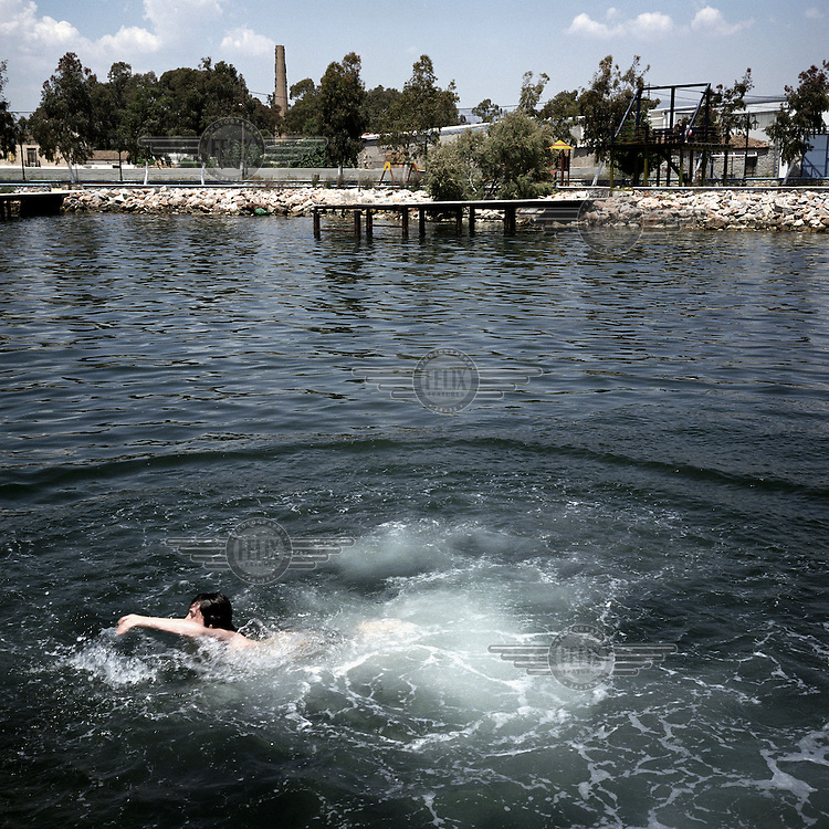 Students swimming in the sea off Elefsina. The area of sea around the town is not safe for swimmers as it is heavily polluted by waste from nearby shipyards, oil refineries, cement factories and tanneries.