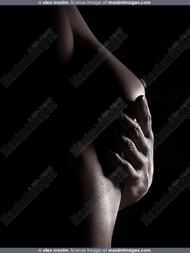 Artistic sensual nude woman body closeup of her hand under her breast, black and white body parts abstract fine art nude photo