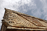 Masks of Chaac, God of the rain, Lattice work, Serpents, Corner of The Nunnery Quadrangle, East Building, 900-1000 AD, with The Temple of the Magician or House of the Dwarf in the distance, Puuc architecture, Uxmal late classical Mayan site, Yucatan, Mexico Picture by Manuel Cohen