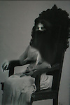 A conceptua image of a sitting woman