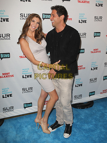 "Heather McDonald, Joe Francis.Bravo's Andy Cohen's Book Release Party For ""Most Talkative: Stories From The Front Lines Of Pop Held at SUR Lounge, West Hollywood, California, USA..May 14th, 2012.full length grey gray jeans denim black jacket dress side arm around waist hug embrace profile .CAP/ADM/KB.©Kevan Brooks/AdMedia/Capital Pictures."
