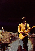 Chicago, Illinois<br /> July 23, 1975<br /> USA<br /> <br /> Guitarist Keith Richards of the Rolling Stones performs live at Chicago Stadium during the band's &quot;Rolling Stones Tour of the Americas '75&quot;.<br /> <br /> This was the Stones first tour with new guitarist Ronnie Wood, after Mick Taylor left the band. The Stones, with their usual act freshly aided by theatrical stage props  including a giant inflatable phallus (nicknamed 'Tired Grandfather' by the band, since it sometimes malfunctioned) and, at the Chicago shows, an unfolding lotus flower-shaped stage that Charlie Watts had conceived.<br /> <br /> The band was composed of  Mick Jagger - vocals, guitar, harmonica, Keith Richards - guitar, vocals, Bill Wyman - bass guitar, and Charlie Watts - drums, percussion. <br /> <br /> Additional musicians included: Ronnie Wood - guitar, backing vocals, Ian Stewart - piano, Billy Preston - keyboards, vocals and Ollie Brown - percussion.