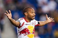 Thierry Henry (14) of the New York Red Bulls reacts to a call. Sporting Kansas City defeated the New York Red Bulls 1-0 during a Major League Soccer (MLS) match at Red Bull Arena in Harrison, NJ, on April 17, 2013.