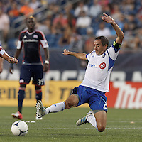 Montreal Impact forward Davy Arnaud (22) stretches to intercept a pass. In a Major League Soccer (MLS) match, Montreal Impact defeated the New England Revolution, 1-0, at Gillette Stadium on August 12, 2012.
