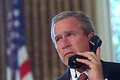 United States President George W. Bush talks with New York Governor George Pataki and New York City Mayor Rudolph Giuliani during a televised telephone conversation in the Oval Office of the White House in Washington, D.C. on Thursday, September 13, 2001. .Mandatory Credit: Eric Draper - White House via CNP.