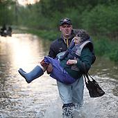 BORKI, POLAND, MAY 24, 2010:.Rescue worker evacuating villager Halina Waszkiewiczowa..The latest chapter of disastrous floods in Poland has been opened yesterday, May 23, 2010, after Vistula river broke its banks and flooded over 25 villages causing evacualtion of most inhabitants..Photo by Piotr Malecki / Napo Images..BORKI, POLSKA, 24/05/2010:.Strazak niesie mieszkanke wsi Haline Waszkiewiczowa. Najnowszy akt straszliwych tegorocznych powodzi zostal rozpoczety wczoraj gdy Wisla przerwala waly na wysokosci wsi Swiniary kolo Plocka..Fot: Piotr Malecki / Napo Images ..
