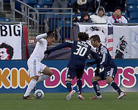 DC United forward Charlie Davies (9) takes on New England Revolution defender Kevin Alston (30) and New England Revolution defender A.J. Soares (5). In a Major League Soccer (MLS) match, the New England Revolution defeated DC United, 2-1, at Gillette Stadium on March 26, 2011.