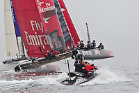 PORTUGAL, Cascais. 6th August 2011. America's Cup World Series. Day 1. EMIRATES TEAM NEW ZEALAND with on the water umpire in the foreground.