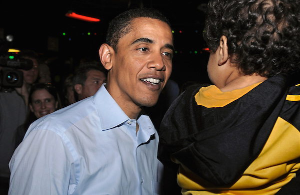 Lafayette, Indiana: May 3, 2008.Presidential candidate Barack Obama looks at a child during a campaign stop at a roller skating rink called Great Skates Fun Center.  ©Christopher Fitzgerald / CandidatePhotos.com