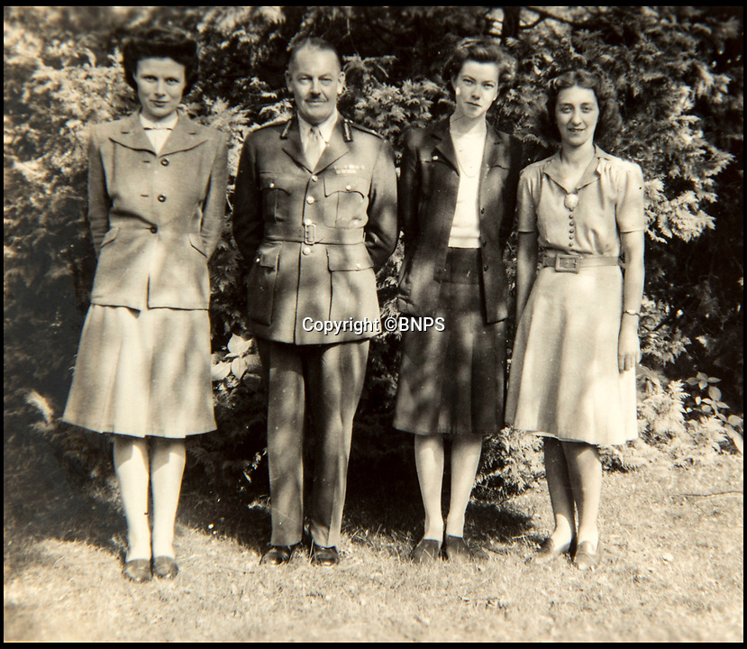 BNPS.co.uk (01202 558833)<br /> Pic: C&amp;T/BNPS<br /> <br /> Brenda(3rd left) with her boss General Hastings Ismay at the villa in Potsdam that became their 'Cabinet Office' in Berlin.<br /> <br /> A humble secretary's remarkable first hand archive of some of the most momentous events of WW2 has come to light.<br /> <br /> 'Miss Brenda Hart' worked in the Cabinet Office during the last two years of the war, travelling across the globe with the Allied leaders as the conflict drew to a close.<br /> <br /> Her unique collection of photographs and momentoes of Churchill, Stalin and other prominent Second World War figures have been unearthed after more than 70 years.<br /> <br /> The scrapbooks, which also feature Lord Mountbatten and Vyacheslav Molotov, were collated by Brenda Hart who, in her role as secretary to Churchill's chief of staff General Hastings Ismay, enjoyed incredible access to him and other world leaders.<br /> <br /> She also wrote a series of letters which give fascinating insights, including watching Churchill and Stalin shaking hands at the Bolshoi ballet in 1944, being behind Churchill as he walked out on to the balcony at the Ministry of Health to to wave to some 50,000 Londoners on VE day and even visiting Hitler's bombed out Reich Chancellery at the end of the war.<br /> <br /> This unique first hand account, captured in a collection of photos, passes, documents and letters are being sold at C&amp;T auctioneers on15th March with a &pound;1200 estimate.