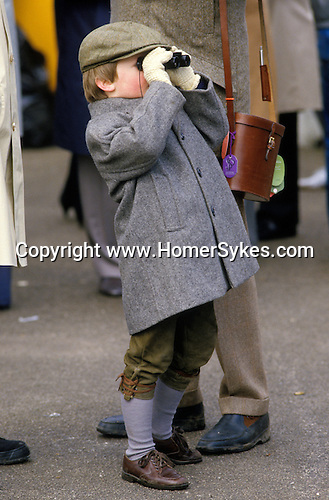 Like father like son, a young boy the Grand National [horse race]   Aintree  Lancashire England