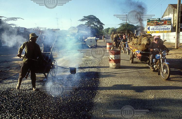 Workers repairing a highway.